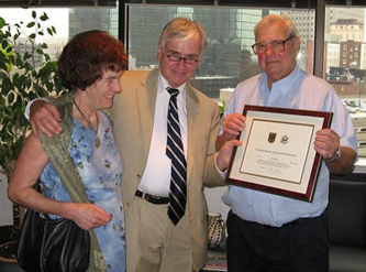 June 2008 presentation of the German Friendship award. Left to right: Veronica Jochum von Moltke (through whom Marc first met Freya, her sister-in-law), German Consul General Dr. Wolfgang Vorwerk, and Mr. Smith.